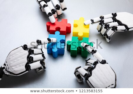 Robot Touching Jigsaw Puzzle Pieces Stock photo © AndreyPopov