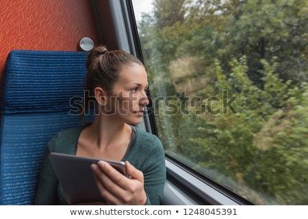 fiatal · nő · táblagép · utazó · vonat · üzlet · számítógép - stock fotó © artfotodima