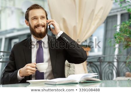 Bonito empresário potável café café da manhã homem Foto stock © Minervastock