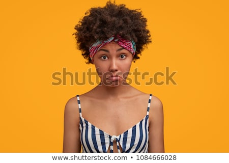 Photo of upset african american woman standing with hands on wai Stock photo © deandrobot