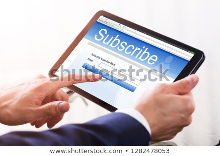 Businessman Filling Online Subscription Form Stock photo © AndreyPopov