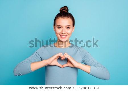 Imagem encantador mulher sorrindo forma de coração barbatana Foto stock © deandrobot