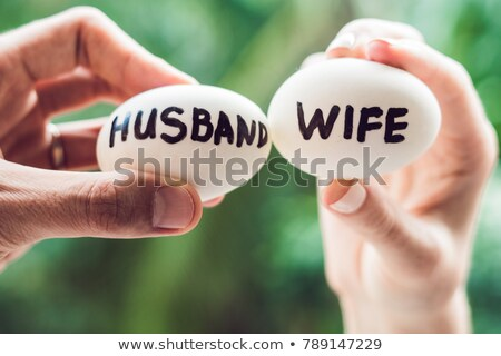 Eggs with inscriptions wife and husband. The conflict between husband and wife Stock photo © galitskaya