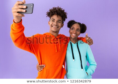 photo of attractive african american brother and sister wearing stock photo © deandrobot