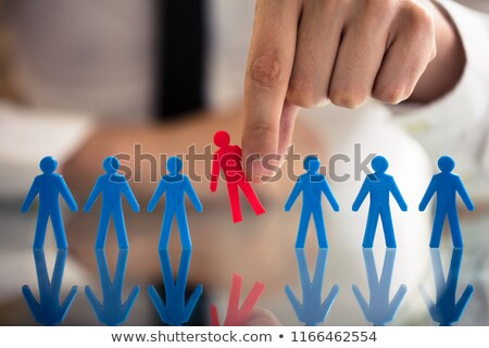 businessperson holding human figures stock photo © andreypopov