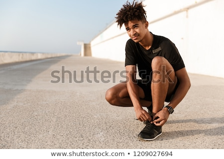 strong young african man dressed in sportswear stock photo © deandrobot