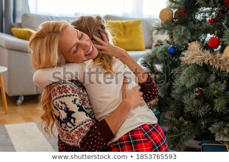 happy mother and daughter with christmas gift stock photo © dolgachov