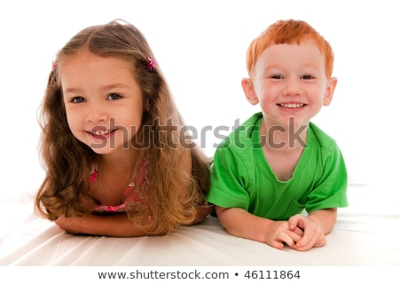 A cute four years boy in white bedding Stock photo © Lopolo