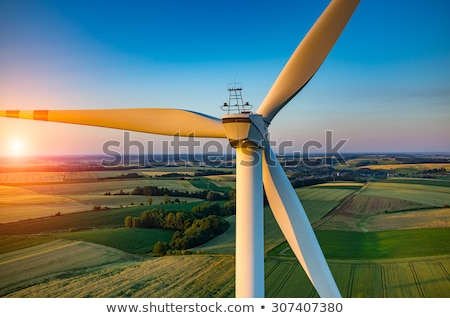 White wind generators mills, wind turbine on green field, wind energy eco concept Stock photo © MarySan