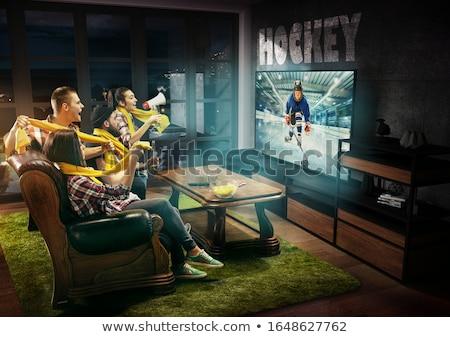man watching ice hockey on tv and drinking beer Stock photo © dolgachov