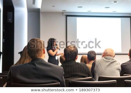 Businessman on podium speaking at conference with windows Stock photo © wavebreak_media