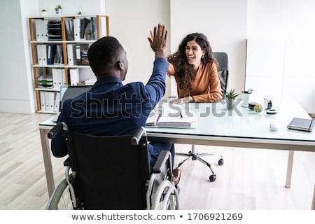 инвалидов бизнесмен high five партнера улыбаясь женщины Сток-фото © AndreyPopov