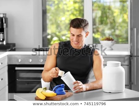 Kulturysta sportowiec białko koktajl sportowe odżywianie Zdjęcia stock © jossdiim