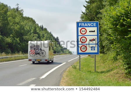 Sign of speed limits at the French border Stock photo © boggy