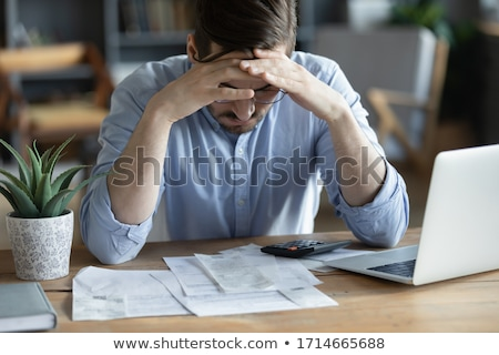 Young businessman totally worried. Stock photo © lichtmeister