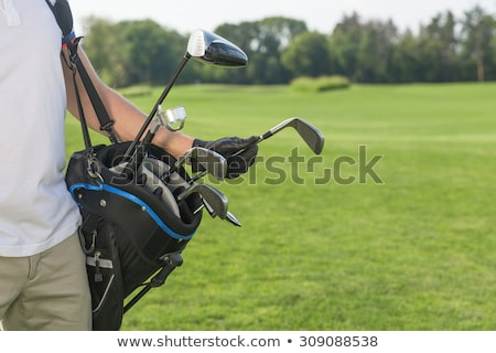 Golfer taking out iron from golf bag. Stock photo © lichtmeister
