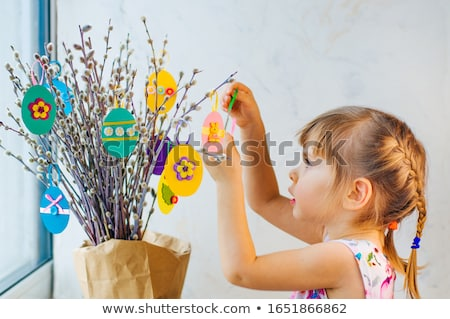 girl with willow decorated by easter eggs at home Stock photo © dolgachov