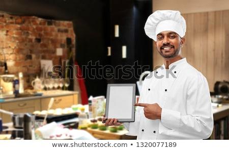Heureux indian chef cuisine cuisson Photo stock © dolgachov