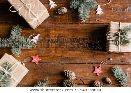 Christmas background made up of giftboxes, pinecones, conifer and decorations Stock photo © pressmaster