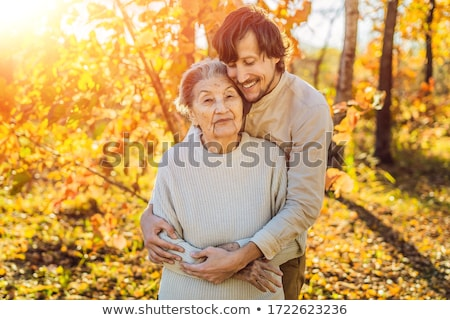 Großmutter Großvater Erwachsenen Enkel Herbst Stock foto © galitskaya