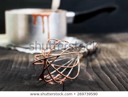 Chef using a metal ladle Stock photo © Kzenon