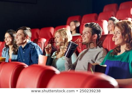 Mosolyog fiú eszik pattogatott kukorica film színház Stock fotó © dolgachov