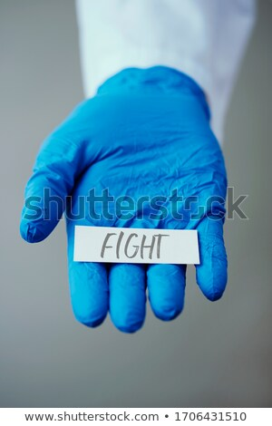 doctor man showing the word fight in a note Stock photo © nito