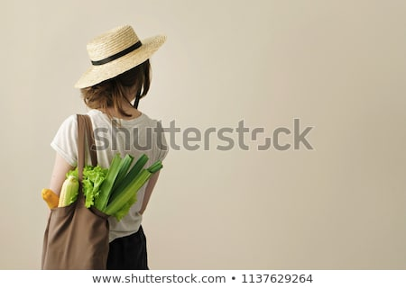 Fresh greens in a reusable bag in the hands of a young woman. Zero waste concept Stock photo © galitskaya