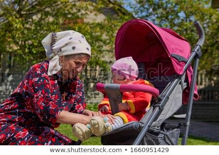 grandmother helping child to put on a shoe. Stock photo © ruslanshramko