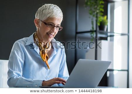 Happy Professional Woman Employee Using Computer Stock photo © AndreyPopov