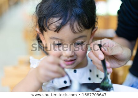Toddler eating chocolate Stock photo © trgowanlock