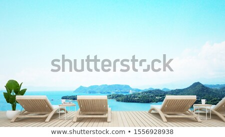 White armchair on natur blue background Stock photo © ElaK