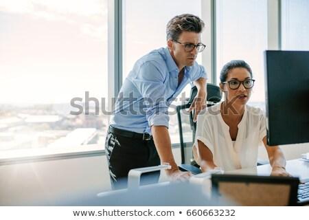 Két férfi ül asztal asztali számítógép iroda internet Stock fotó © photography33