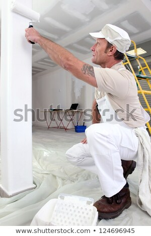 Stock photo: Painter with roller kneeling down