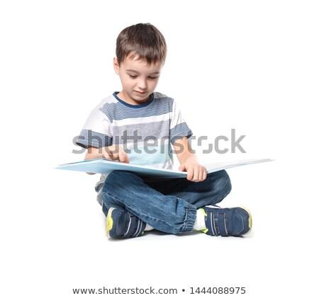 weinig · jongen · vergadering · boeken · geïsoleerd · witte - stockfoto © zurijeta