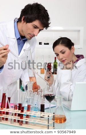 Man and woman conducting experiment on wine Stock photo © photography33