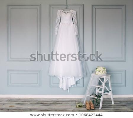Beautiful blonde woman in blue dress in luxury interior. Stock photo © Pilgrimego