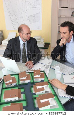 Architects gathered around a desk exchanging ideas Stock photo © photography33