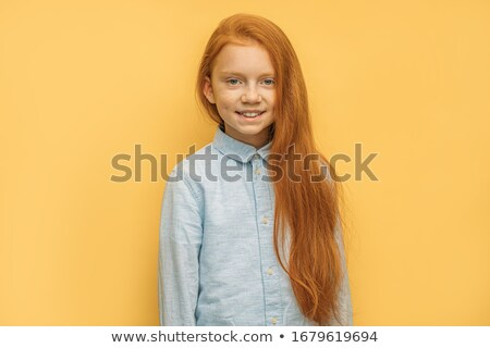 Snapshot of a cheerful schoolgirl Stock photo © stockyimages