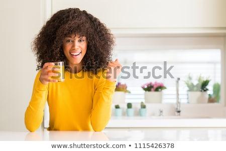młoda · kobieta · szkła · sok · pomarańczowy · rano · posiedzenia - zdjęcia stock © photography33