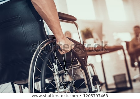 Stock photo: Close-up of a businessman sitting on a wheelchair