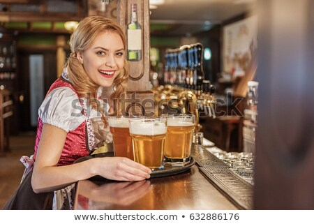 Waitress carrying beer on tray Stock photo © photography33