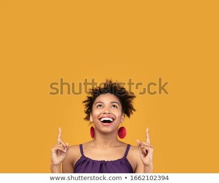 Mulher jovem olhando maravilhado acima marrom Foto stock © rosipro