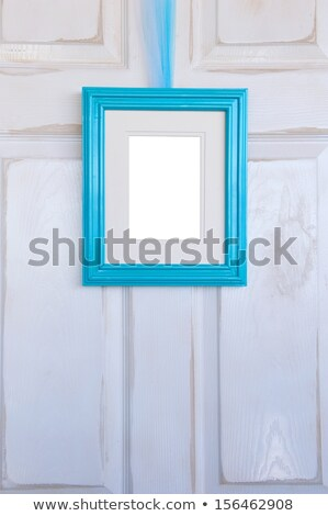 Blank Turquoise Picture Frame On Distressed Door Stock fotó © pixelsnap