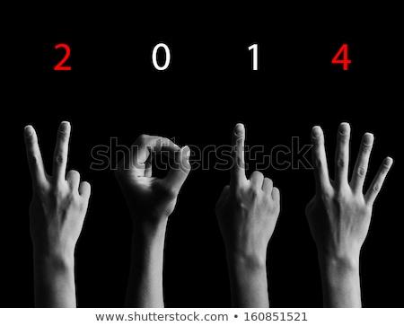 числа 2014 пальцы Creative Новый год приветствие Сток-фото © ashumskiy