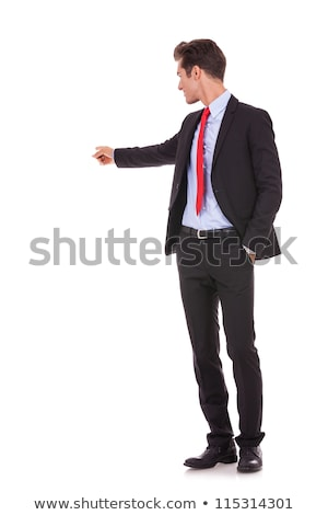 back of a young business man pointing his finger stock photo © feedough