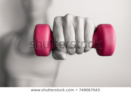 muscled woman with barbells stock photo © nobilior