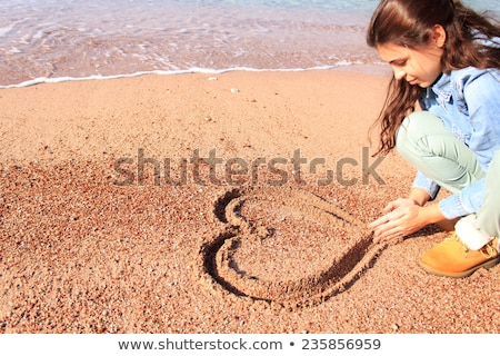 woman beach drawing heart sand stock photo © hasloo