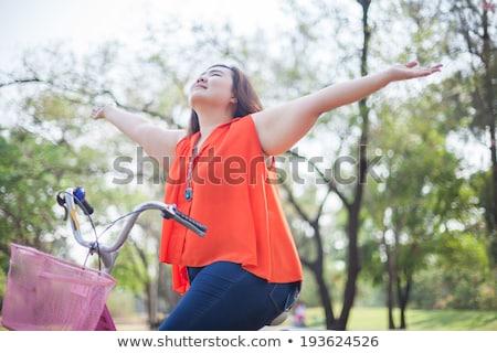 feliz · gorduroso · mulher · posando · ao · ar · livre · asiático - foto stock © witthaya