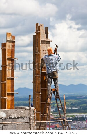 portrait of construction worker laying bricks stock photo © highwaystarz